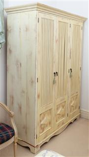 Sale 8990H - Lot 62 - A pine and yellow painted shabby chic three drawer wardrobe, Height 209cm x Width 160cm x Depth 68cm