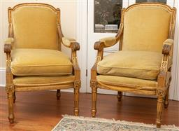 Sale 9190W - Lot 29 - A pair of French giltwood Fauteuils, upholstered with feather and down velvet covered cushions.. Height 103 x width 66 x depth 73cm...