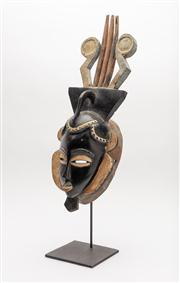 Sale 8844 - Lot 55 - An African, (Ivory Coast) dance mask on stand with lyre shaped headdress. Height 54cm (total height 64cm including stand). Label ver...