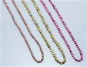 Sale 9037F - Lot 4 - THREE ROPE LENGTH FRESHWATER PEARL NECKLACES; 6-8mm keshi cultured pearls in green, fuschia and light green, lengths 130cm.