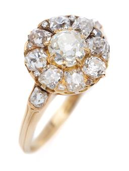Sale 9194 - Lot 383 - A VINTAGE DIAMOND CLUSTER RING; centring an Old European cut diamond of approx. 0.51ct to a surround of 8 Old European and Old mine...