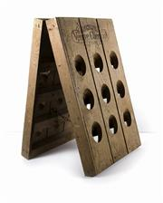 Sale 8224A - Lot 88 - A rare old French oak eighteen bottle riddling wine / champagne rack, made for 'Veuve Cliquot', 60 x 57 cm