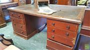 Sale 8402 - Lot 1059 - Late 19th Century Cedar Partners Desk, with brown inset top, having eight drawers & two panel doors, top drawer with a name (faults)