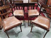 Sale 8939 - Lot 1088 - Set of Six Regency Simulated & Rosewood Veneered Dining Chairs, with brass inlaid details, caned seats with loose leather cushions &...