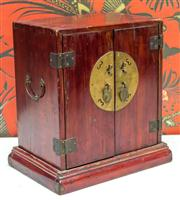 Sale 8222 - Lot 8 - A miniature oriental two door cabinet, with three internal drawers, H 33cm, W 26, D 17 Film Provenance; Moulin Rouge, 2001