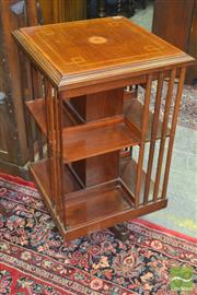 Sale 8255 - Lot 1038 - Good Edwardian Inlaid Mahogany Revolving Bookcase, of two tiers with bat-wing inlay