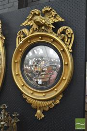 Sale 8255 - Lot 1030 - Regency Style Gilt Gesso Convex Mirror, with ebonised slip & surmounted by an eagle
