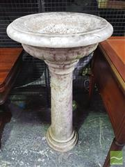 Sale 8416 - Lot 1074 - Antique White Marble Bird Bath, the shallow urn top with reeded base, on a turned pedestal (slight chipping, distressed finish)
