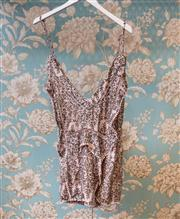 Sale 8474A - Lot 16 - A cute Zimmerman drawstring playsuit, in soft pink featuring low v front & back design with mini pom pom fringing, excellent conditi...