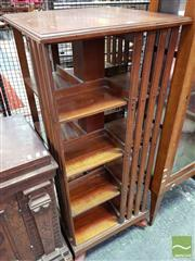 Sale 8485 - Lot 1011 - Late Victorian Walnut Revolving Bookcase, of four tiers, with unusual inverted castors for rotating