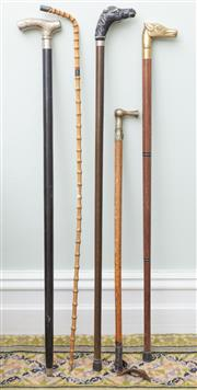 Sale 8653A - Lot 70 - A group lot of various walking sticks including cane and two with horse head handles, and riding crop