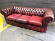 Sale 9014 - Lot 1085 - Burgundy Three-Seater Chesterfield Lounge, buttoned & with pleated front (h:85 x w:170cm)