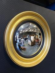 Sale 9031 - Lot 1019 - Regency Style Gilt Convex Mirror, with deep moulded frame & ebonised reeded slip (D85cm)