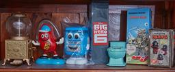 Sale 9103H - Lot 24 - A shelf lot of collectors items including Jelly Belly dispensers, Mechanical Walking Spaceman etc