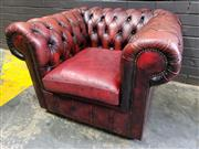 Sale 9014 - Lot 1086 - Burgundy Leather Chesterfield Armchair, buttoned & with pleated apron (h:65 x w:90cm)