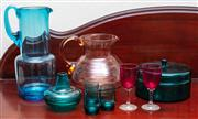 Sale 9058H - Lot 42 - A group of coloured glassware to include a hand blown aqua lemonade jug, three teal liquer glasses, two cranberry glass stemmed liqu...