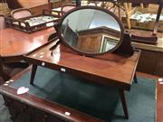 Sale 8676 - Lot 1079 - Unusual Edwardian Mahogany Bed Lap Table & Toilet Mirror, the oval mirror collapsible & with folding legs