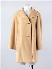 Sale 8760F - Lot 143 - A Max Mara virgin wool coat in camel, size 8