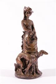 Sale 9010D - Lot 733 - A Cast Metal Figure Of Lady with Hound H: 24cm