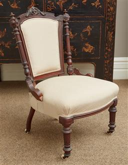 Sale 9108H - Lot 2 - A small carved walnut occasional chair with polka dot upholstery raised on castors. Height of back 80cm