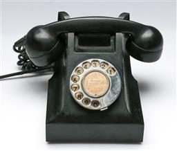 Sale 9156 - Lot 207 - A vintage Black Bakelite rotary telephone c1950s, as found to cords,