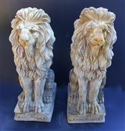 Sale 8256A - Lot 37 - A pair of cast stone lion figures - some small chips/ wea. Size: 60 x 20 cm