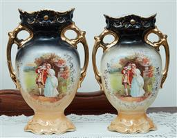 Sale 9103M - Lot 550 - A pair of continental twin handle vases with gilt decoration, chip to one rim, Height 27.5cm