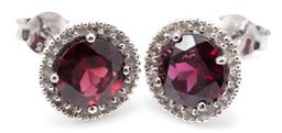 Sale 9186 - Lot 327 - A PAIR OF GARNET AND TOPAZ CLUSTER STUD EARRINGS; each set in silver with a round cut rhodolite garnet of approx. 1.61ct surrounded...