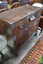 Sale 8335 - Lot 1075 - Korean Pine & Iron Bound Chest, with lift lid & hinged front, raised on legs (Key in Office)