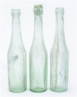 Sale 9185E - Lot 50 - A set of three tinted glass bottles, Height 22cm