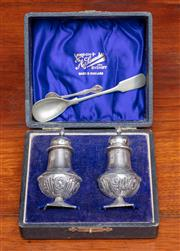 Sale 9058H - Lot 36 - A boxed silver salt and pepper set by Saunders, each height 9cm, Birmingham marks together with a condiment spoon and a Canadian sil...