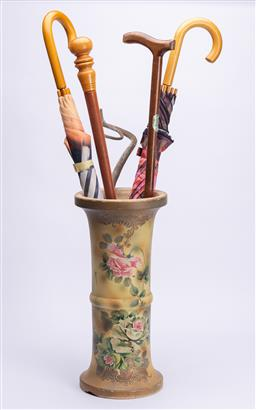 Sale 9185E - Lot 147 - A floral decorated ceramic umbrella stand, with losses together with sundry sticks and umbrellas, stand Height 45.5cm