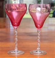 Sale 9058H - Lot 41 - A pair of cranberry glass wine glasses with clear twist stems, Height 20cm