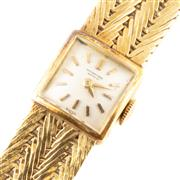 Sale 8857 - Lot 333 - A VINTAGE INTERNATIONAL WATCH CO. 18CT GOLD LADY'S WRISTWATCH; square white dial applied markers, 17 jewel cal. 431 movement, no. 16..
