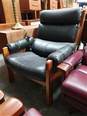 Sale 8930 - Lot 1082 - Hunter Style Leather Armchair