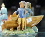 Sale 7969 - Lot 16 - Majolica Figure of Boy with Boat, chip