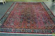 Sale 8576 - Lot 1041 - Large Persian Wool Carpet, with repeating interlocking pattern on a red ground, with cream border (350 x 280cm)