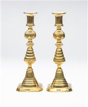 Sale 8651A - Lot 98 - A pair of English brass column candlesticks with ejectors, Registered design number 223560, c. 1894, H 24cm