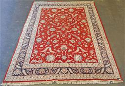 Sale 9126 - Lot 1020 - Persian hand knotted woollen rug with red field, blue & cream tone border (360 x 271cm)