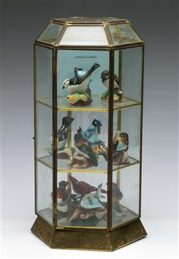 Sale 9164 - Lot 197 - A hexagonal display case with a collection of ceramic bird figures inc European Gold Finch (H:32.5cm)