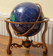Sale 8677B - Lot 515 - A terrestrial globe inlaid with semi precious stones on a gimbal stand, total diameter 30cm