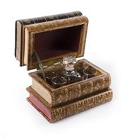 Sale 8224A - Lot 99 - An early French secret book stack liquor decanter, overall size 15 x 12 x 18 cm