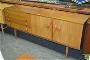 Sale 8260 - Lot 1043 - Rare Beautility Teak Sideboard with nice door configuration