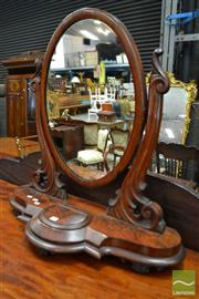 Sale 8500 - Lot 1031 - Large Victorian Flame Mahogany Toilet Mirror, with carved supports & hinged compartment
