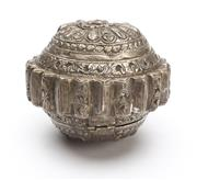 Sale 8517A - Lot 89 - A hinged silver circular domed repousse tobacco box with radiating floral motif and ribbed edge, Sumbawa, 84g, D 10cm
