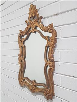 Sale 9179 - Lot 1022 - Baroque Style Carved Gilt Mirror, with scrolled pierced frame & crest (h:77 x w: 46 cm)