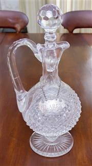 Sale 8346A - Lot 21 - An early C19th strawberry cut glass claret jug with star cut base, H 32cm, with stopper, together with a silver bottle ticket with L...