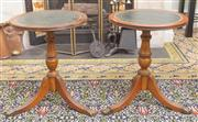 Sale 8653A - Lot 82 - A pair of matching leather inlaid wine tables, each H 48cm, on tripod base ending in paw feet