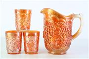 Sale 8957C - Lot 628 - Large orange Imperial Grape water pitcher (H21.5cm, very small chip to base) together with a set of three tumblers