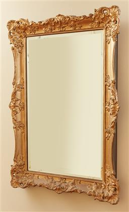 Sale 9098H - Lot 5 - A rectangular bevelled mirror in a gilt frame in the rococo style, 92cm x 62cm